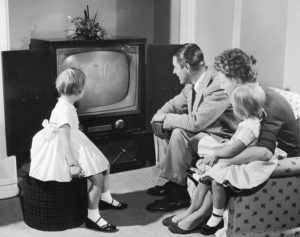 CT68T6 Family gathered around television